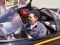 Adam takes the original Batmobile for a spin; Dan road tests Nissan's electric LEAF; women learn to drive a stick; guest IMSA driver Steve Millen.